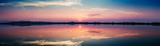Fototapety Perfectly specular reflection on the salt pans at sunset - panoramic view
