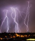Fototapety Lightning over city skyline