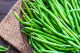 Green beans or string beans on rustic wood.