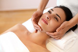 Fototapety Beautiful Young Woman Getting a Face Treatment at Beauty Salon.