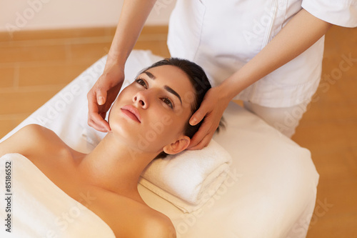 Face Massage. Close-up of a Young Woman Getting Spa Treatment. - 85186552