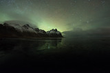 Fototapeta Northern lights over frozen lake Vestrahorn in Iceland