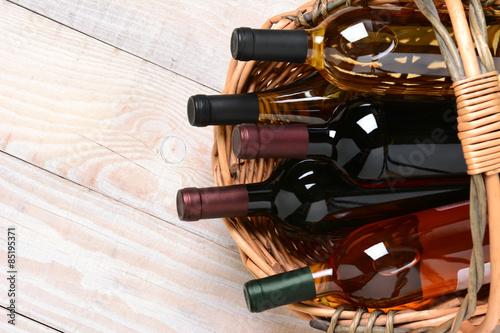 Basket of Wine Bottles Poster