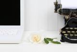 Rose on Desk Between Laptop and Typewriter