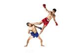 Fototapeta Two thai boxers exercising traditional martial art