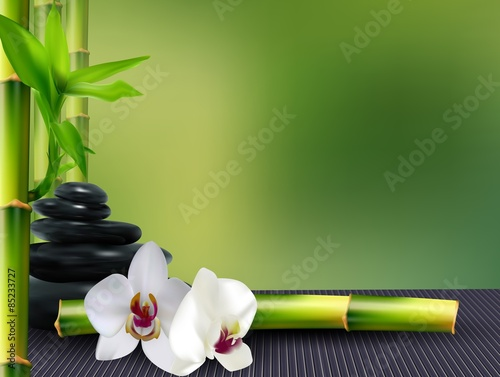 Fototapeta Stone, flower and bamboo on the table background