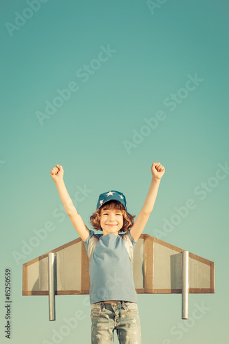Happy child playing outdoors