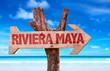 Riviera Maya wooden sign with beach background