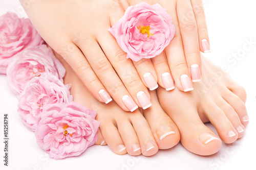 Foto op Canvas Pedicure Relaxing pedicure and manicure with a pink rose flower