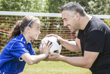 Fototapety teenager girl with father play soccer
