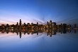 Chicago Skyline Reflecting On Lake Michigan