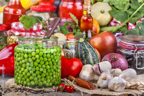 Canned peas with different fruits and vegetables in the background © egostock