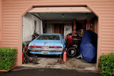 Looking into a cluttered home garage poster