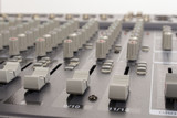 Close-up of audio mixing board sliders