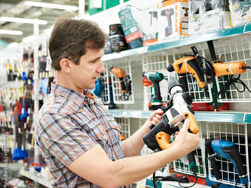 Man shopping for perforator in hardware store