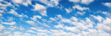 Fototapeta Fluffy white clouds on blue sky panorama