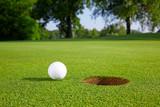 Fototapety Golf ball on the green