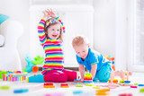 Fototapety Kids playing with wooden blocks