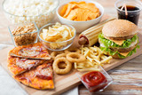 Fototapety close up of fast food snacks and drink on table