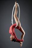 Image of flexible dance performer on aerial hoop