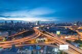 Aerial view of Bangkok overpass night severe traffic congestion during twilight poster