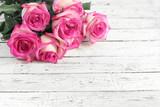 Fototapeta roses on wooden background