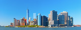 Fototapety New York City lower Manhattan financial  wall street district buildings skyline on a beautiful summer day with blue sky