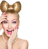 Beauty surprised model girl with funny bow hairstyle