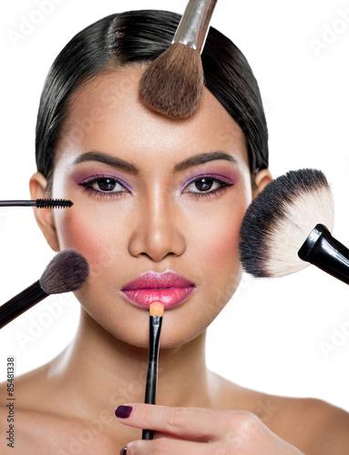 Obraz na Szkle many hands applying make up on a woman