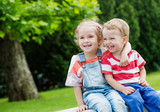 Happy Toddler brother and sister hugging - Fine Art prints