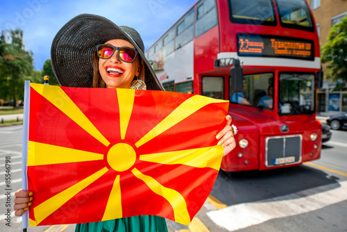 Poster Woman with macedonian flag in Skopje city