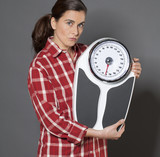 casual 30s woman skeptical about her scales for weight loss poster