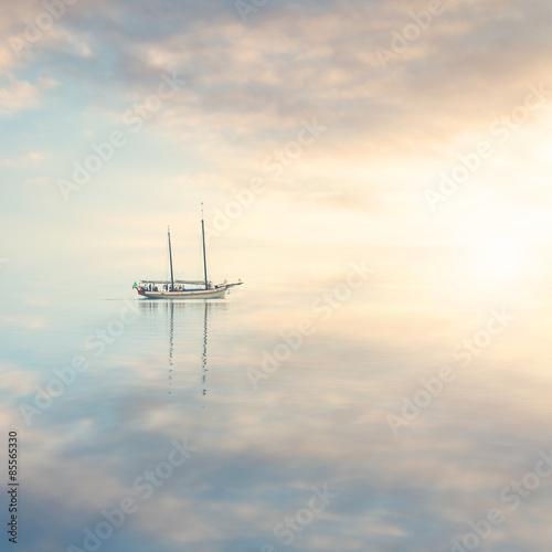 Fototapeta Boat in the calm water silence