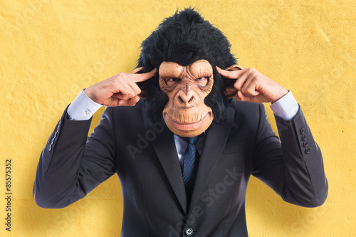 Monkey man thinking over white background Poster
