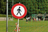 Violating the prohibition to walk the grass of a sports field. poster