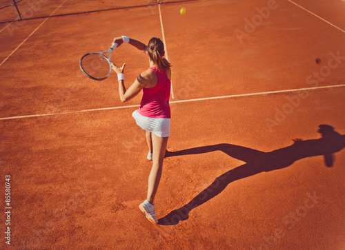 Plakát Young woman playing tennis.High angle view.Forehand.