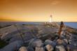 peggys cove lighthouse nova scotia sunset