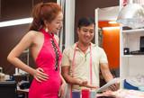 designer asian man tailor shop show tablet design woman