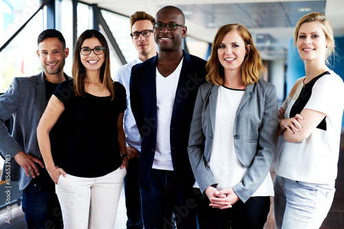 Group of young executives posing for picture