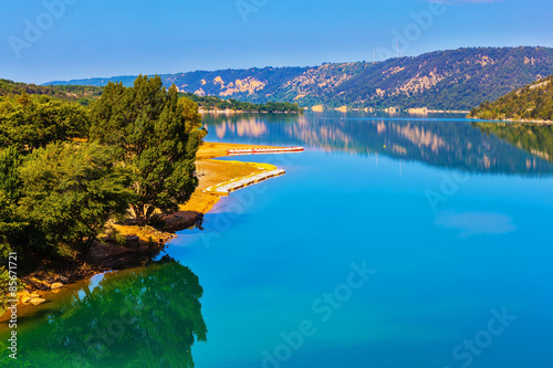 Lake Sainte-Croix-du-Verdon reflects wooded shore