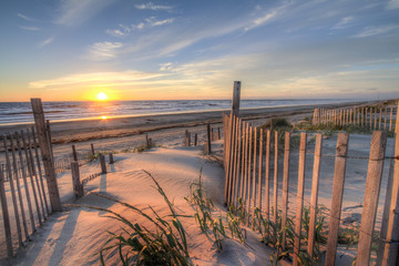 Sunrise as seen from the sand dunes at the Outer Banks, NC around Corolla Beach in September, 2014. © sauseyphotos
