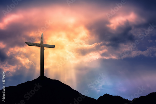 Silhouette of Cross at Sunrise