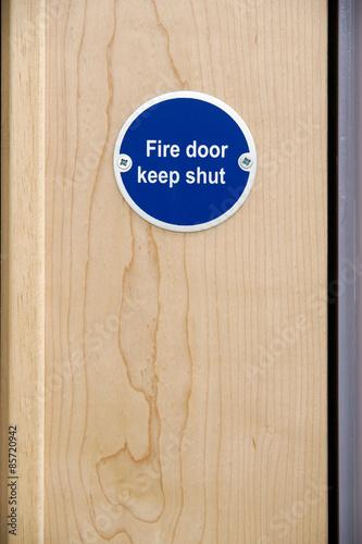 Poster Fire door keep shut sign on an office door