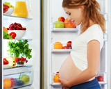 Fototapety nutrition and diet during pregnancy. Pregnant woman with fruits