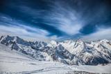 Fototapety Snowy peaks against the blue sky