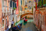 Fototapeta Gondolas on lateral narrow Canal in Venice, Italy