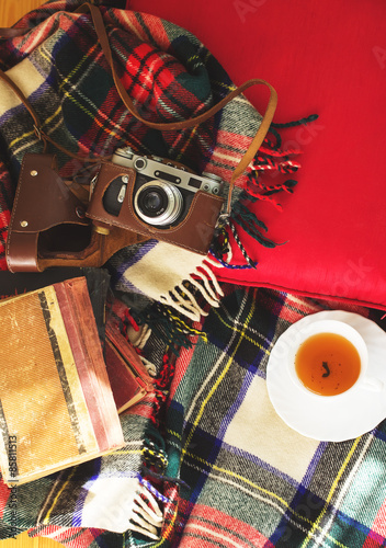 Poster Composition with  cup of tea, vintage camera, old books on sofa with plaid