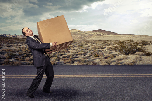 Man carrying large carton box Poster