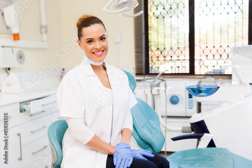 Poster female dentist in office