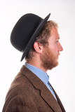 Profile of a bearded man in an old-fashioned Victorian bowler